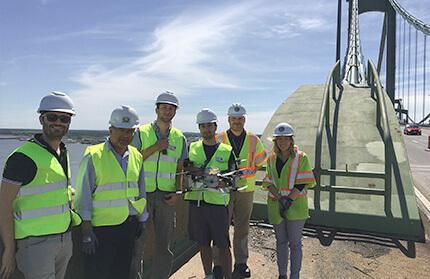 bridge personnel and drone crew on bridge