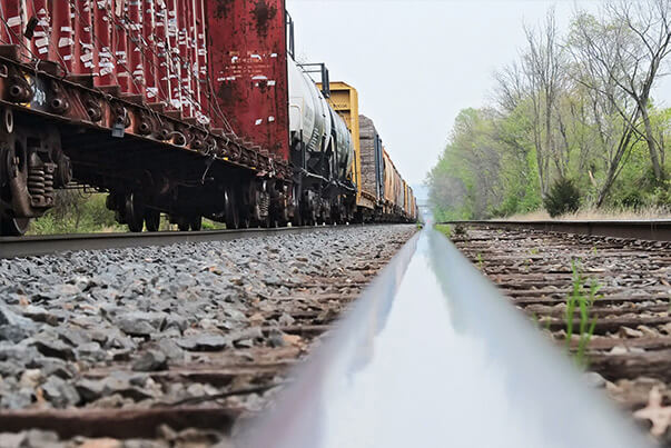 Low view of rail and freight train