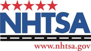 NHTSA logo, blue letters with red stars on top