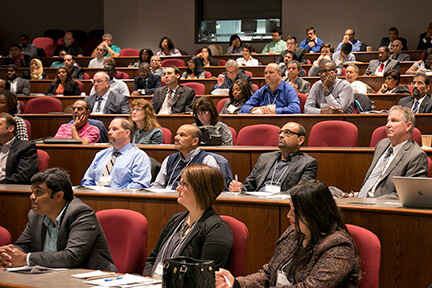 photo of audience at a large conference