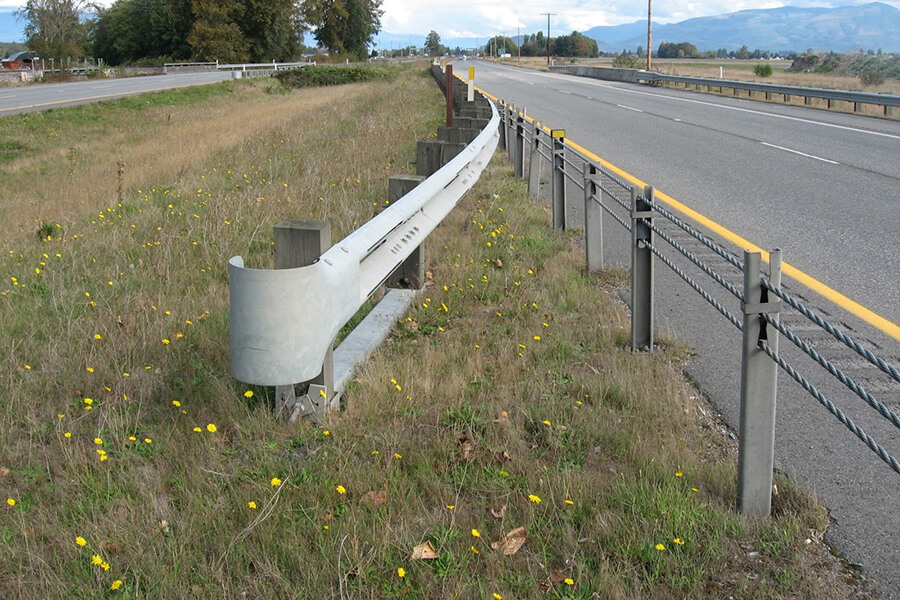 cable barriers to help reduce drivers from crossing through the median into oncoming traffic. Photo: WSDOT.