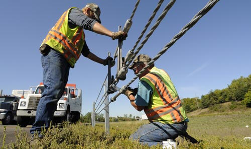 Minnesota DOT workers installing cable barrier